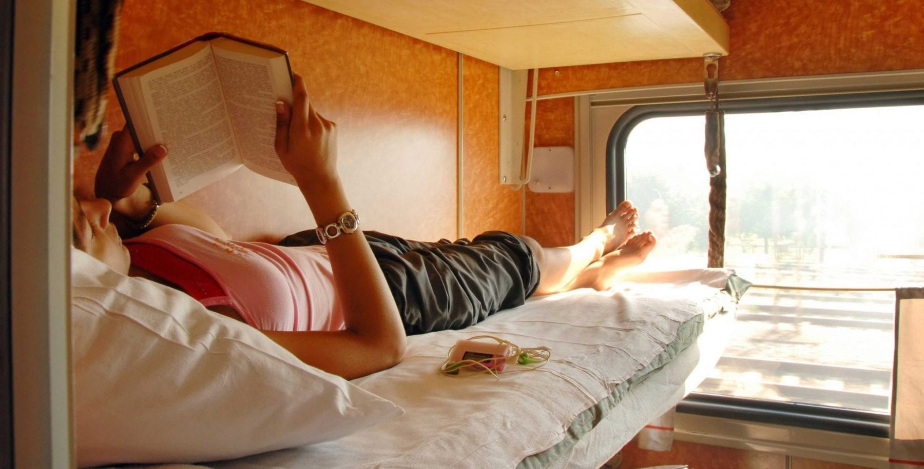 Man sleeping on train with possibility of bringing home bed bugs