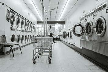A laundromat with aisles of washing machines.