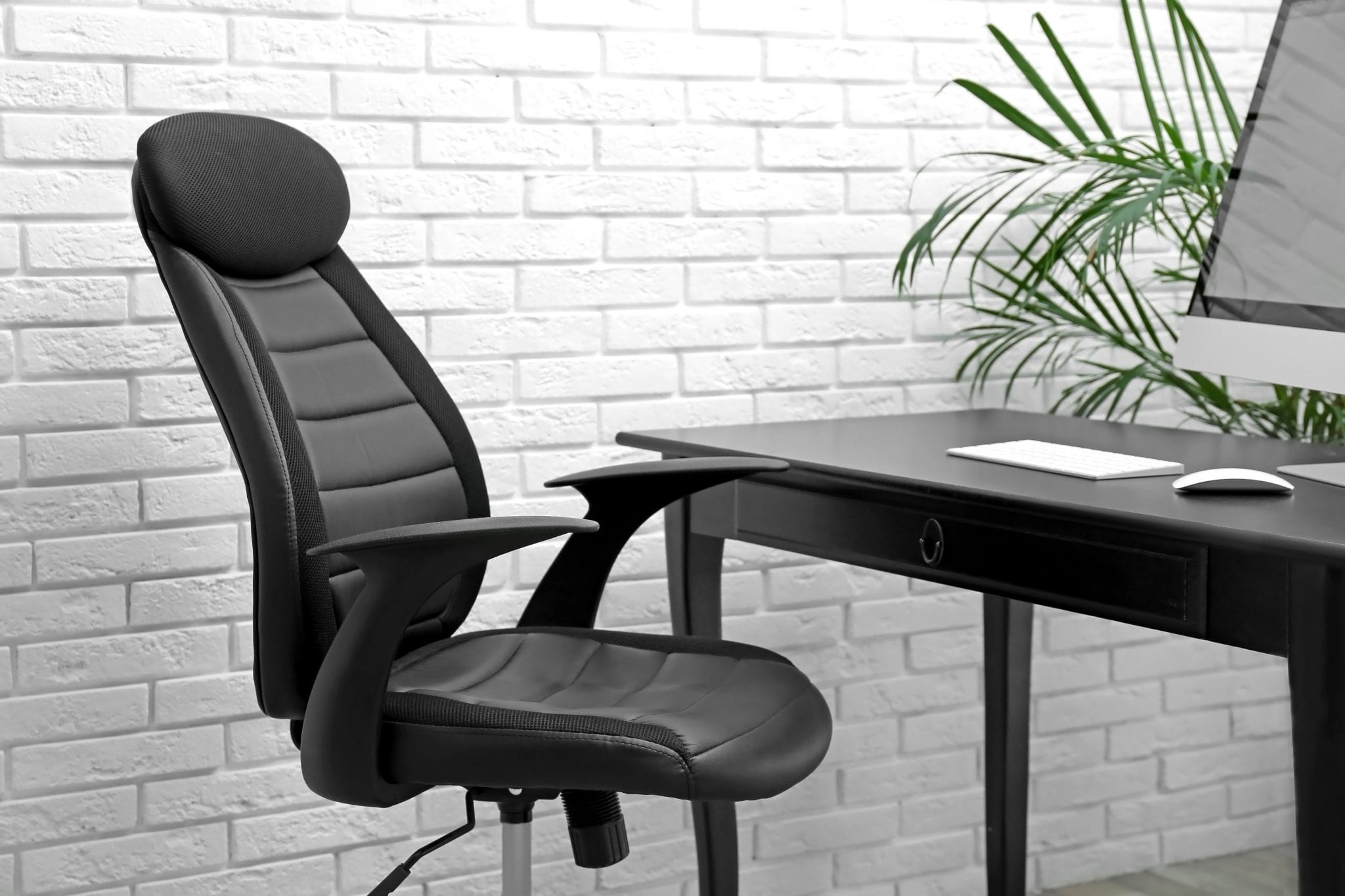 Stylish workplace interior with modern office chair